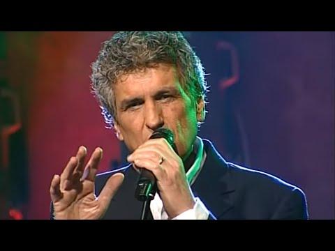 Music video Toto Cutugno - Un falco chiuso in gabbia