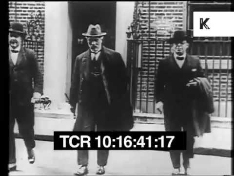 1920s, Stanley Baldwin and Ramsay MacDonald at no. 10 Downing St. Winston Churchill smiles to camera