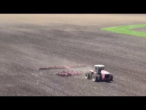 Spring Tillage in Illinois with two Versatile 550 Tractors pulling field cultivators.