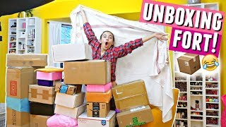 I made a fort out of all my packages and then did an unboxing haul.