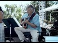 Attorney Joe Saunders playing guitar at the Clearwater Jazz Holiday 2014