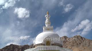 Timelapse of clouds moving behind Shanti Stupa and Leh city