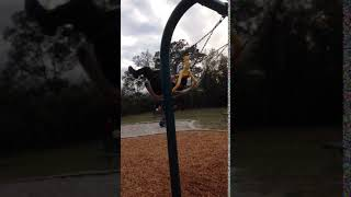 Hoodclips  a kid in black falls off a assisted swing
