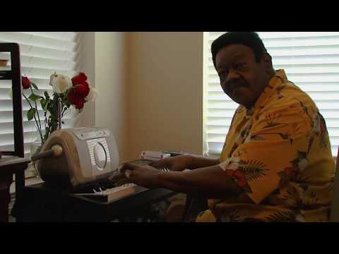 Fats Domino playing piano at home