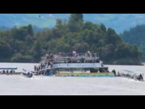 Watch Rescuers Rush to Scene as Tourist Boat Sinks!  Yikes!