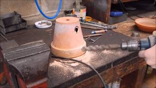 Melt aluminium in a flower pot furnace