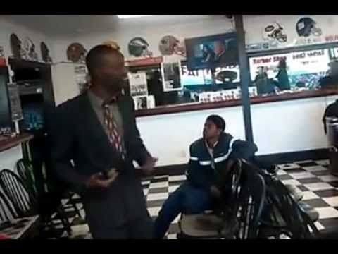 Guy in Fatheadz barbershop singing his pain