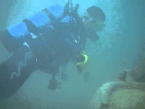 Son and I diving around a sunk crane