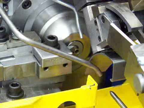 Saginaw Machine Systems - BRUT Universal Trimming Machine performing bullet case trimming