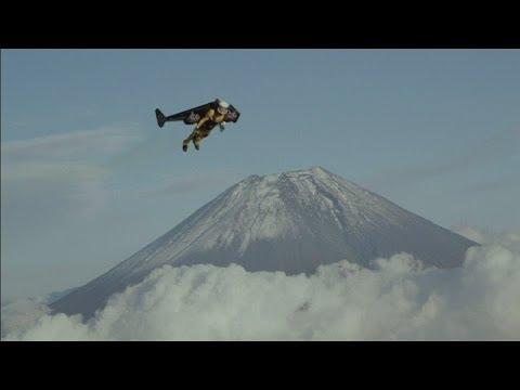 Jetman flies over Mount Fuji: Yves Rossy soars over Japanese volcano using jet pack