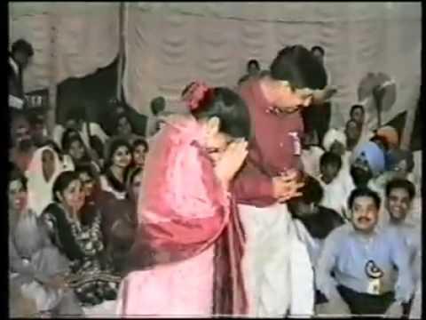 Sangat Dancing in front of Guru Ji