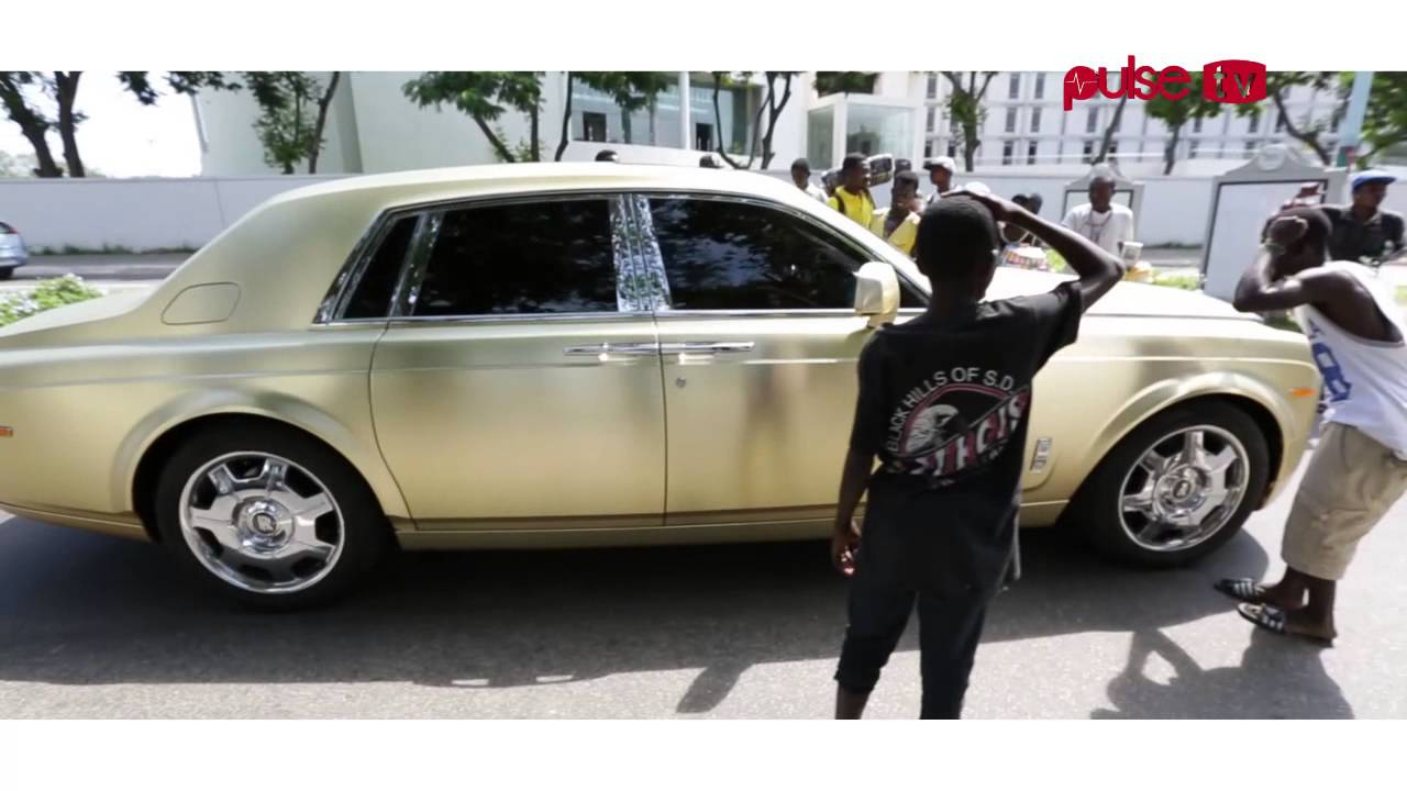 asamoah gyan lands in accra with his rolls royce 'baby jet'. - youtube