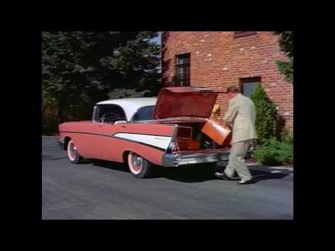 1950s Packing Suitcases into Cars Stock Footage HD