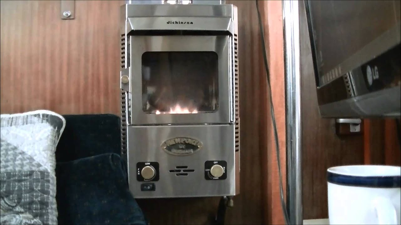 "Showing my Dickinson Newport P12000 propane heater that I use on my sailboat. 7000-9700 btu 4-5.5 hr/1 lb propane Wt 22lbs. Height 19"" Width 10.25"" Depth 8.1..."