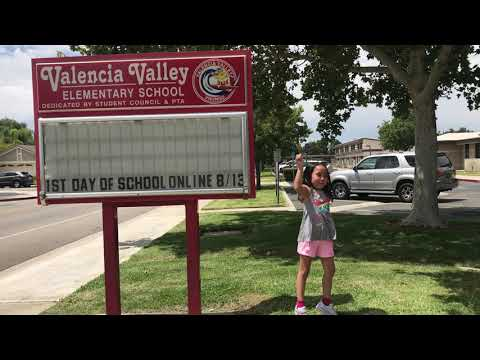 Ella dancing in front of Valencia Valley Elementary School on the 1st  Day of Distance Learning.
