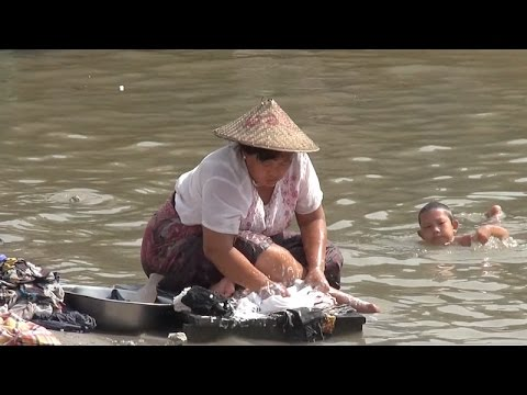 Working on the banks of the Ayeyarwady River, Mandalay, Myanmar
