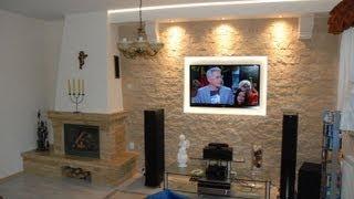 Стіна з Телевізором у вітальні з каміном - декоративний Камінь-декоративний на стіні тв - TvWande