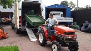Parkowanie z przyczepą do busa japońskim traktorkiem ogrodowym.www.traktorki-japonskie.waw.pl