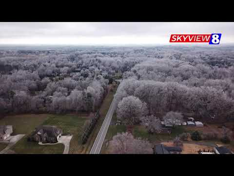 SkyView8 flies above ice-covered trees in Guilford County