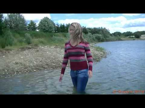 Katka swims in sweater and jeans