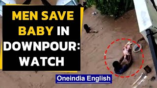 Bengaluru rains: Viral video shows men rescue baby | Oneindia News