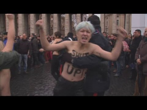 Topless Femen protesters strike Vatican as The Pope holds prayers