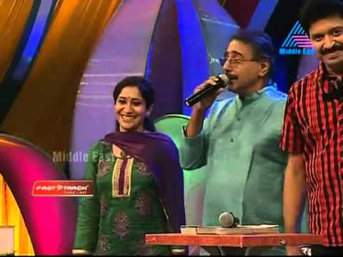 Singer Sujatha Mohan and her husband Mohan singing live
