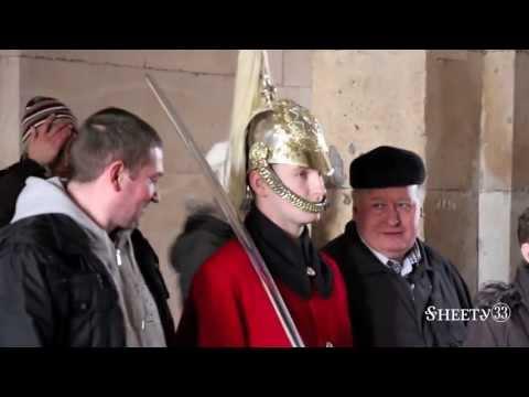 Tourist Touches London Guards Sword