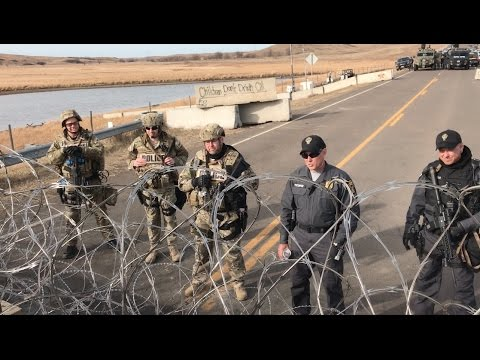 Militarized police confront Megan Ritzi (an amputee) at DAPL
