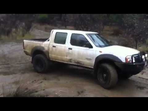 lifted nissan navara d22 fun burnouts in the mud youtube. Black Bedroom Furniture Sets. Home Design Ideas