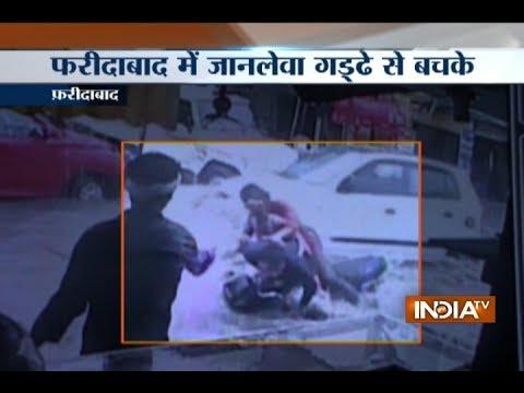 Commuters fall as water logging hides potholes at Sarai Khwaja in Faridabad