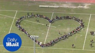 Students across southern Florida walk out to protest lax gun laws - Daily Mail