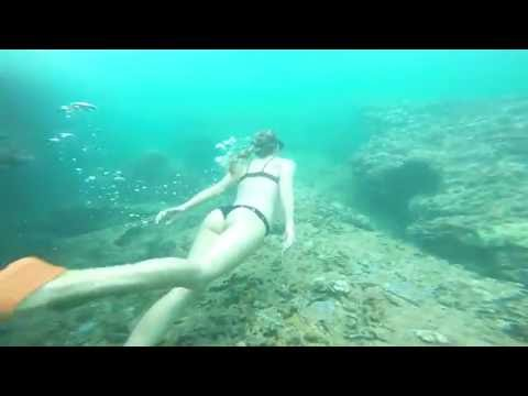 Mermaids diving in caves at Sharks Cove North Shore Oahu