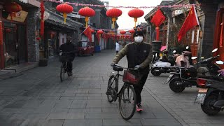 Beijing increases coronavirus preventive measures as offices and stores reopen