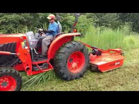 Kubota Grand L6060 Bush-Hogging Elephant Grass