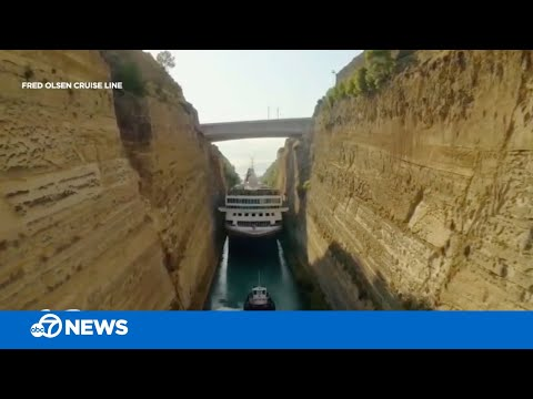 Cruise ship makes tight squeeze through canal