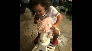 Ezzie And Her First Rocking Horse