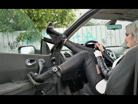 WOMAN DRIVING IN LEATHER LEGGINS AND HIGH HEELS