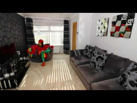 A Man dressed as a parrot and took lots of pictures to sell a house!
