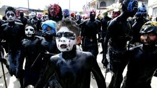 Youths painted in black for Mexican carnival