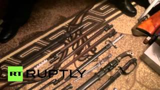 RAW: Police show off weapons found in bomb making factory raid in Moscow