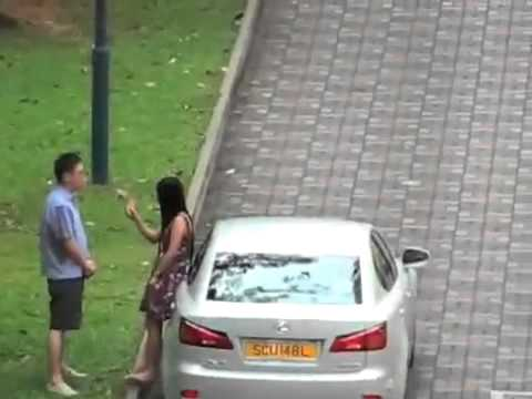 A Singapore woman hits a man in the groin.