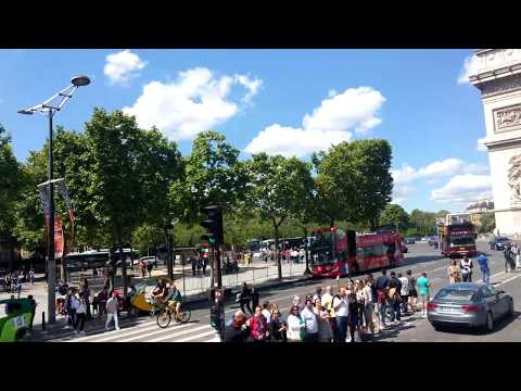 Bus ride on Avenue des Champs-Elysees in Paris