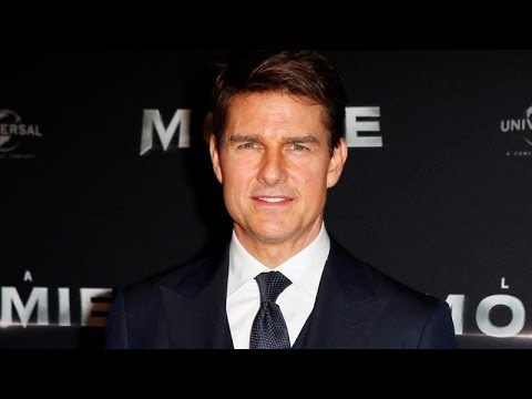 Tom Cruise Limps Away After Stunt On