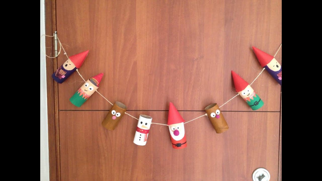 Especial de navidad banner con rollos tubos de papel for Puertas decoradas navidad material reciclable