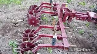 Робота ротаційної борони по картоплі .