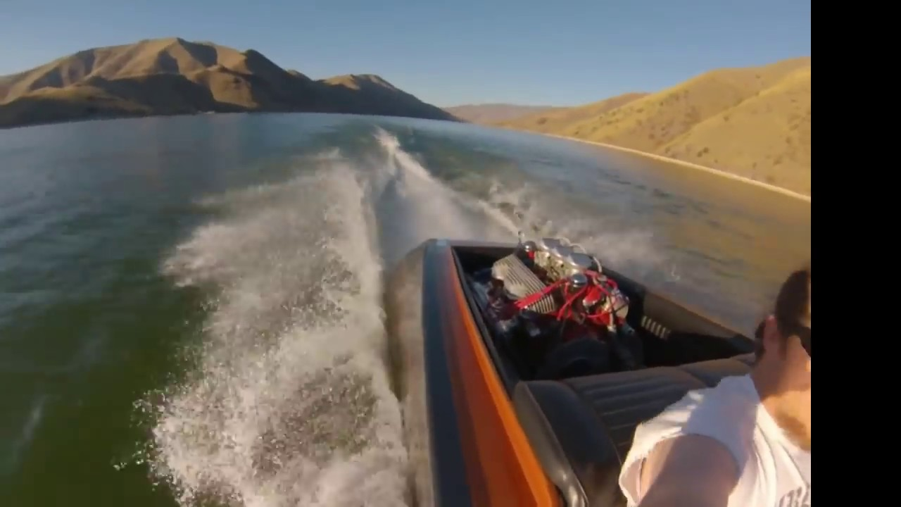 Fast 51 year old flat bottom woody v-drive boat restored and repainted