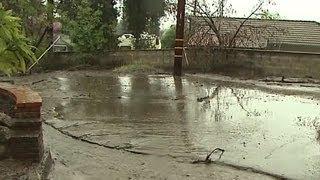 Rain slams west coast with mud slides