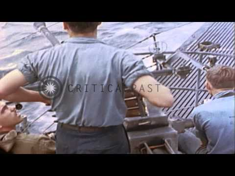 US submarine picks up Japanese survivors from boat disabled by its gunfire in Wor...HD Stock Footage
