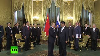 RAW: Chinese president arrives in Russia, meets with Putin